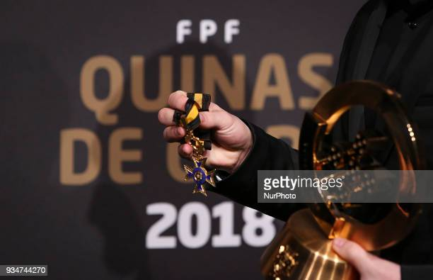 Portugal's futsal player Ricardinho shows the awards at 'Quinas de Ouro' ceremony held at Pavilhao Carlos Lopes in Lisbon on March 19 2018