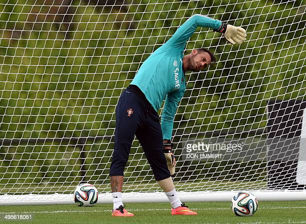 Portugal's gaolkeeper Beto does some stretching during training June 4 2014 in Florham Park New Jersey Portugal made a stop in the US for training...