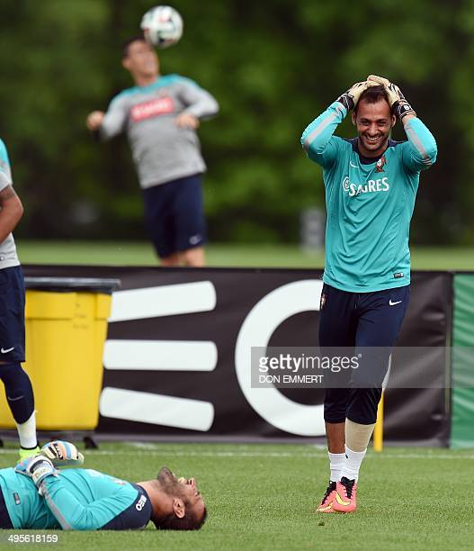 Portugal's gaolkeepers share a laugh while warming up during training June 4 2014 in Florham Park New Jersey Portugal made a stop in the US for...