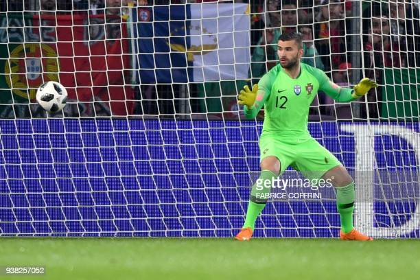 Portugal's goalkeeper Anthony Lopes looks on as a shot from Netherlands' forward Memphis Depay passes him on the way to goal during the international...