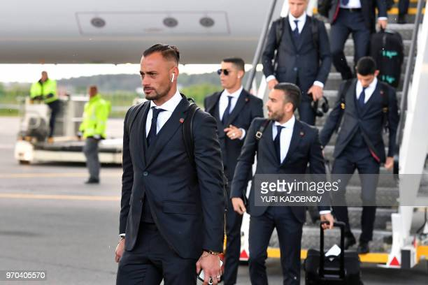 Portugal's goalkeeper Beto and teammates disembark from a plane at the Zhukovsky airport about 40 kilometres southeast of Moscow city centre on June...