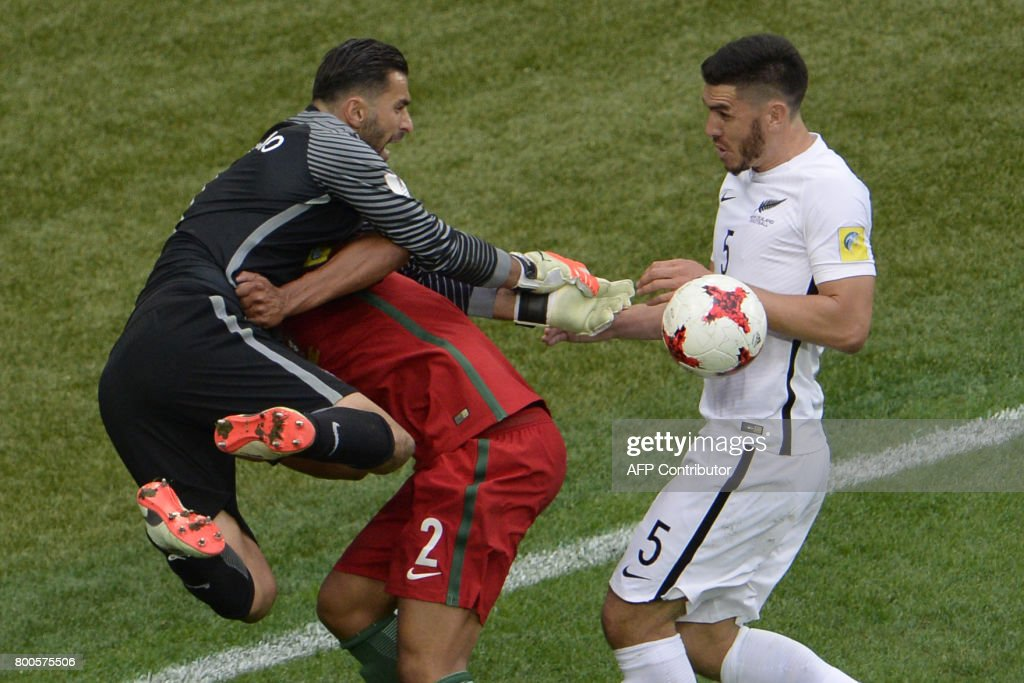 Portugal's goalkeeper Rui Patricio (L) and Portugal's defender Bruno Alves vie with New Zealand's defender Michael Boxall during the 2017 Confederations Cup group A football match between New Zealand and Portugal at the Saint Petersburg Stadium in Saint Petersburg on June 24, 2017. / AFP PHOTO / Olga MALTSEVA