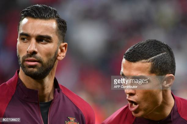 Portugal's goalkeeper Rui Patricio and Portugal's forward Cristiano Ronaldo sing the national anthem at the start of the 2017 Confederations Cup...