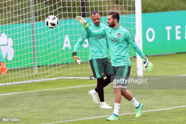 Portugal's goalkeeper Rui Patricio and Portugal's goalkeeper Beto in action during a training session at Cidade do Futebol training camp in Oeiras...