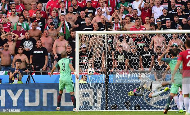 TOPSHOT Portugal's goalkeeper Rui Patricio conceces a goal during the Euro 2016 group F football match between Hungary and Portugal at the Parc...