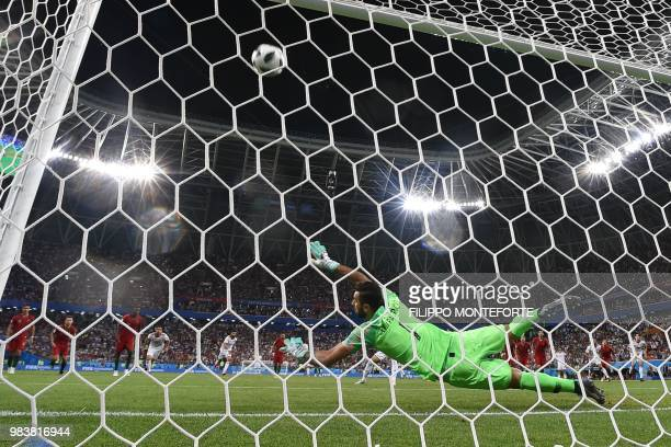 TOPSHOT Portugal's goalkeeper Rui Patricio fails to save the penalty during the Russia 2018 World Cup Group B football match between Iran and...