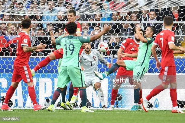TOPSHOT Portugal's goalkeeper Rui Patricio reacts as players vie for the ball during the 2017 Confederations Cup group A football match between...