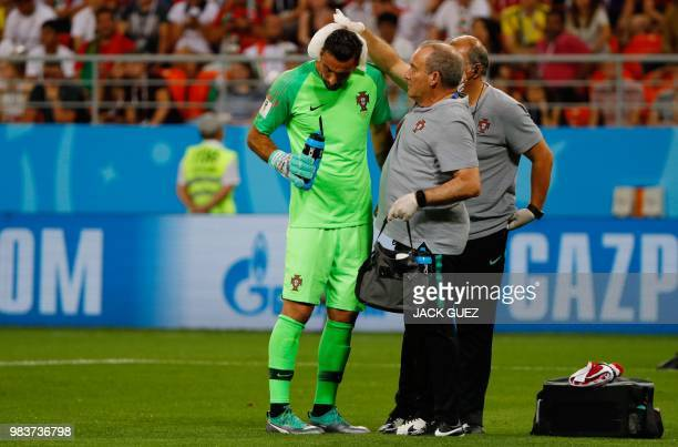 Portugal's goalkeeper Rui Patricio receives treatment during the Russia 2018 World Cup Group B football match between Iran and Portugal at the...