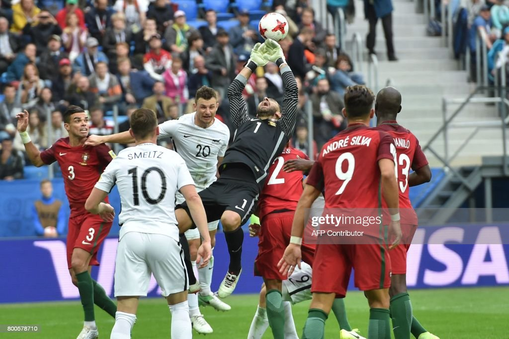 Portugal's goalkeeper Rui Patricio (C) saves the ball during the 2017 Confederations Cup group A football match between New Zealand and Portugal at the Saint Petersburg Stadium in Saint Petersburg on June 24, 2017. / AFP PHOTO / Mladen ANTONOV