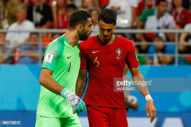 Portugal's goalkeeper Rui Patricio speaks with Portugal's defender Jose Fonte during the Russia 2018 World Cup Group B football match between Iran...