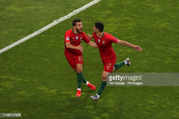 Portugal's Goncalo Guedes celebrates scoring his side's first goal of the game with team-mate Bernardo Silva during the Nations League Final at...