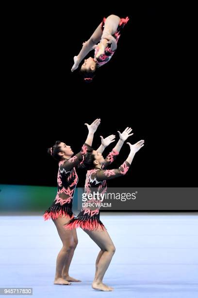 Portugal's group Isis Coutinho Ana Fontes and Ana Pratas perform on the first day of the 26th edition of the Acrobatic Gymnastics world championships...