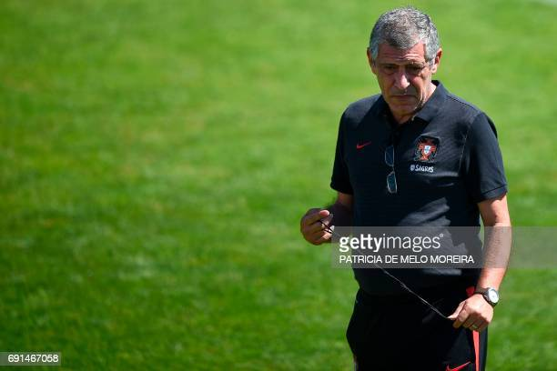 Portugal's head coach Fernando Santos stands on the pitch during a training session at 'Cidade do Futebol' training camp in Oeiras outskirts of...