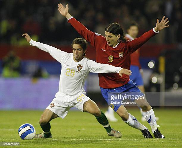 Portugal's Joao Moutinho challenges for the ball with Serbia's Marko Pantelic during their Euro 2008 Group A qualifying soccer match in Belgrade,...