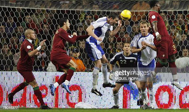 Portugal's Jose Bosingwa Cristiano Ronaldo and Makukula try to score against Finland next to Toni Kallio goalkeeper Jussi Jaaskelainen and Sami...