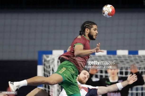 Portugal's left back Andre Gomes passes the ball past Norway's centre back Christian O'Sullivan during the 2021 World Men's Handball Championship...