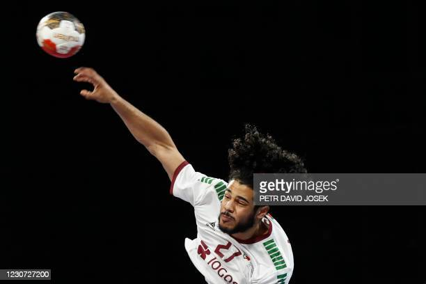 Portugal's left back Andre Gomes shoots the ball during the 2021 World Men's Handball Championship between Group III teams Switzerland and Portugal...
