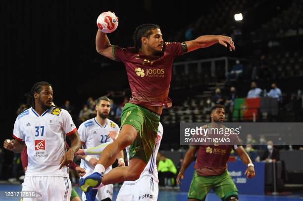 Portugal's left back Andre Gomes takes a shot during the IHF Men's Tokyo Handball Qualification 2020 match between Portugal and France at the Sud de...