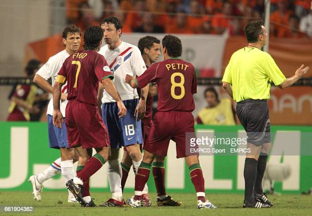 Portugal's Luis Figo and Holland's Mark Van Bommel square up to each other during the second half.