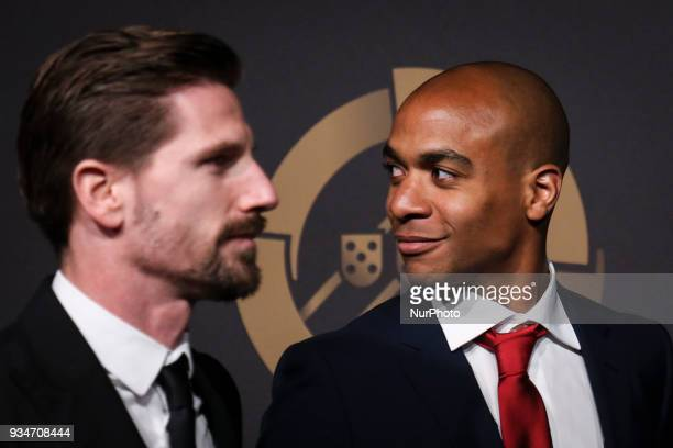 Portugal's midfielder Adrien Silva accompanied by Portugal's midfielder Joao Mario pose on arrival at quotQuinas de Ouroquot ceremony held at...