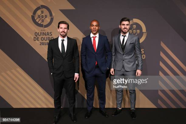 Portugal's midfielder Adrien Silva accompanied by Portugal's midfielder Joao Mario and Dany poses on arrival at 'Quinas de Ouro' 2018 ceremony held...