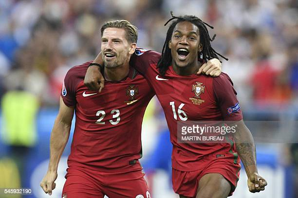 Portugal's midfielder Adrien Silva ans Portugal's midfielder Renato Sanches celebrate after beating their hosts France 10 in the Euro 2016 final...