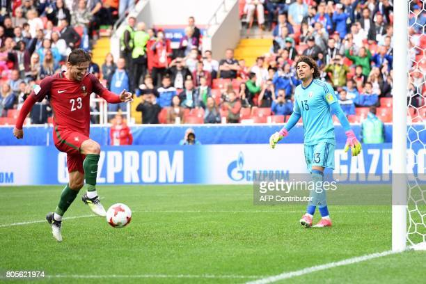 Portugal's midfielder Adrien Silva celebrates next to Mexico's goalkeeper Guillermo Ochoa after scoring a penalty during the 2017 FIFA Confederations...