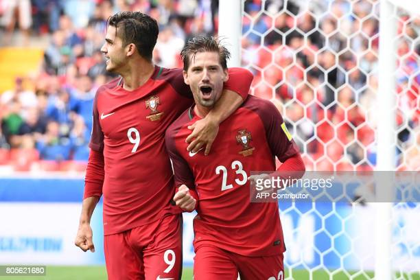 TOPSHOT Portugal's midfielder Adrien Silva celebrates with Portugal's forward Andre Silva after scoring his team's winning goal during the 2017 FIFA...
