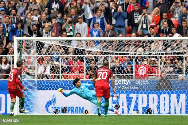 TOPSHOT Portugal's midfielder Adrien Silva scores a penalty during the 2017 FIFA Confederations Cup third place football match between Portugal and...