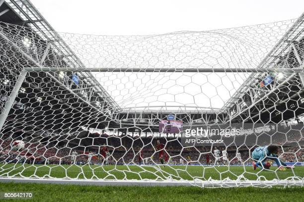 TOPSHOT Portugal's midfielder Adrien Silva scores a penalty past Mexico's goalkeeper Guillermo Ochoa during the 2017 FIFA Confederations Cup third...