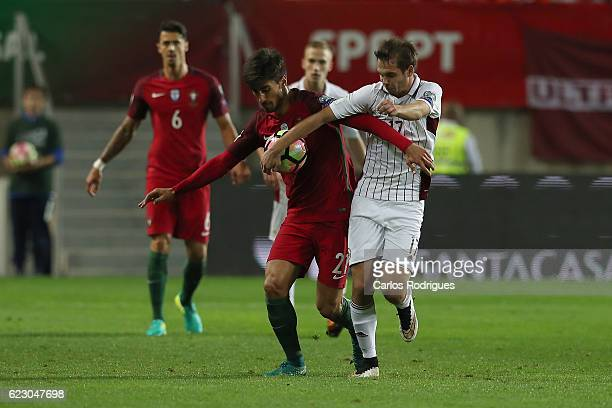 Portugal's midfielder Andre Gomes from Portugal vies with Latvia's midfielder Arturs Zjuzins from Latvia during the Portugal v Latvia FIFA 2018 World...