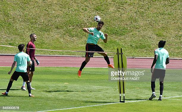 Portugal's midfielder Andre Gomes heads the ball during a training session at their base camp in Marcoussis near Paris on July 7 2016 during the Euro...