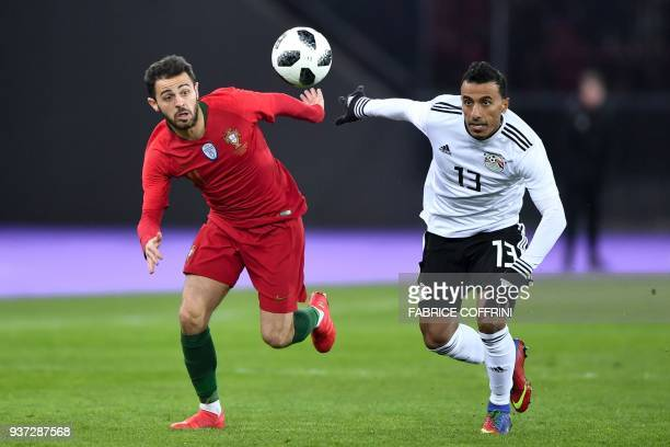 Portugal's midfielder Bernardo Silva and Egypt's defender Mohamed Abdel Shafy vies during an international friendly football match between Portugal...