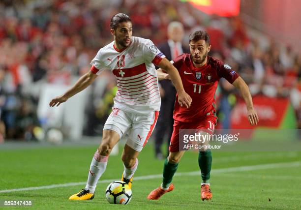 Portugals midfielder Bernardo Silva and Switzerland's defender Ricardo Rodriguez vie for the ball during the FIFA World Cup 2018 Group B qualifier...