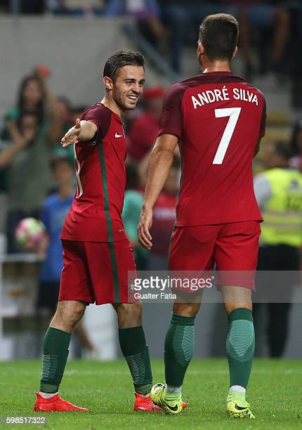 PortugalÕs midfielder Bernardo Silva celebrates with teammate PortugalÕs forward Andre Silva after scoring a goal during the International Friendly...