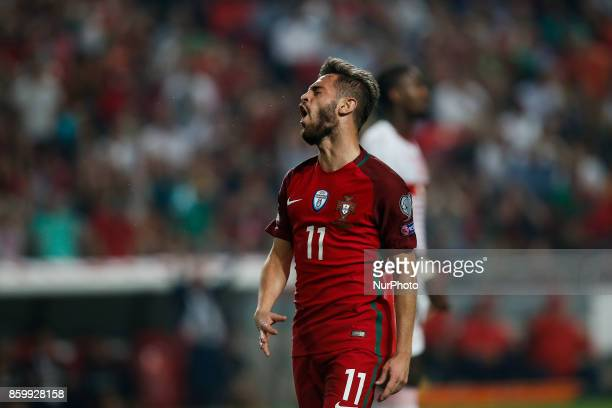 Portugal's midfielder Bernardo Silva reacts during the FIFA World Cup WC 2018 football qualifier match between Portugal and Switzerland in Lisbon on...