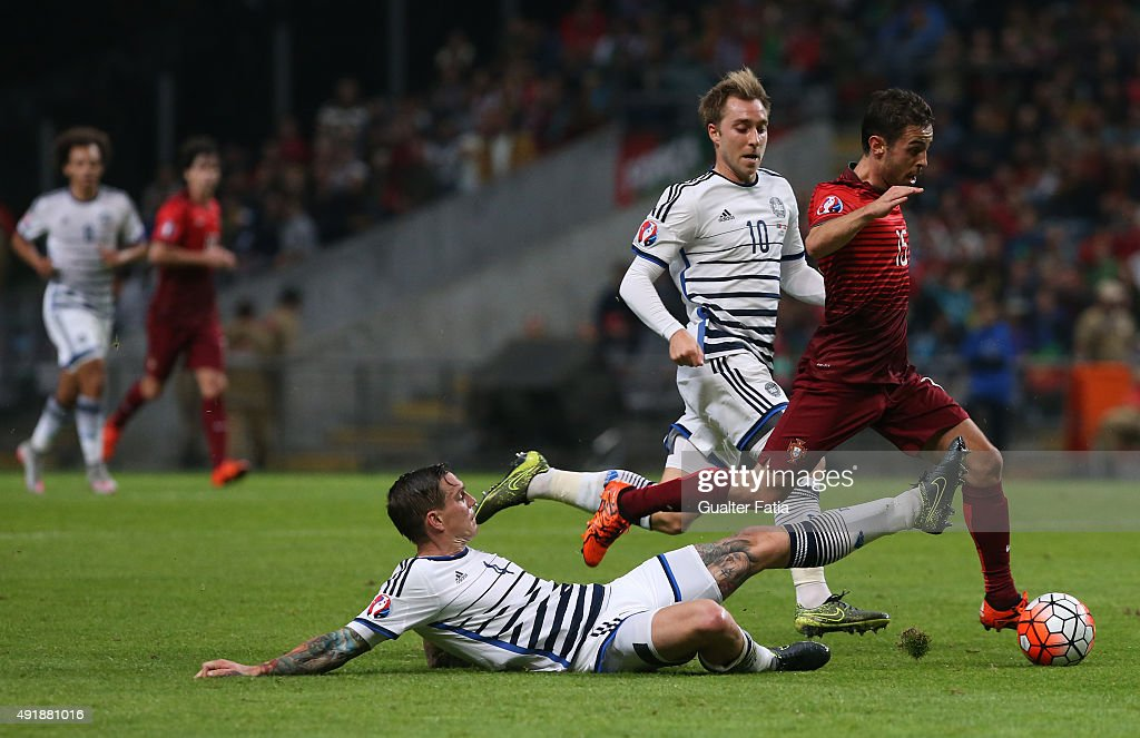 Portugal's midfielder Bernardo Silva with Denmark's Daniel Agger and Denmark's Christian Eriksen in action during the UEFA EURO 2016 Qualifier match between Portugal and Denmark at Estadio Municipal de Braga on October 8, 2015 in Braga Portugal.