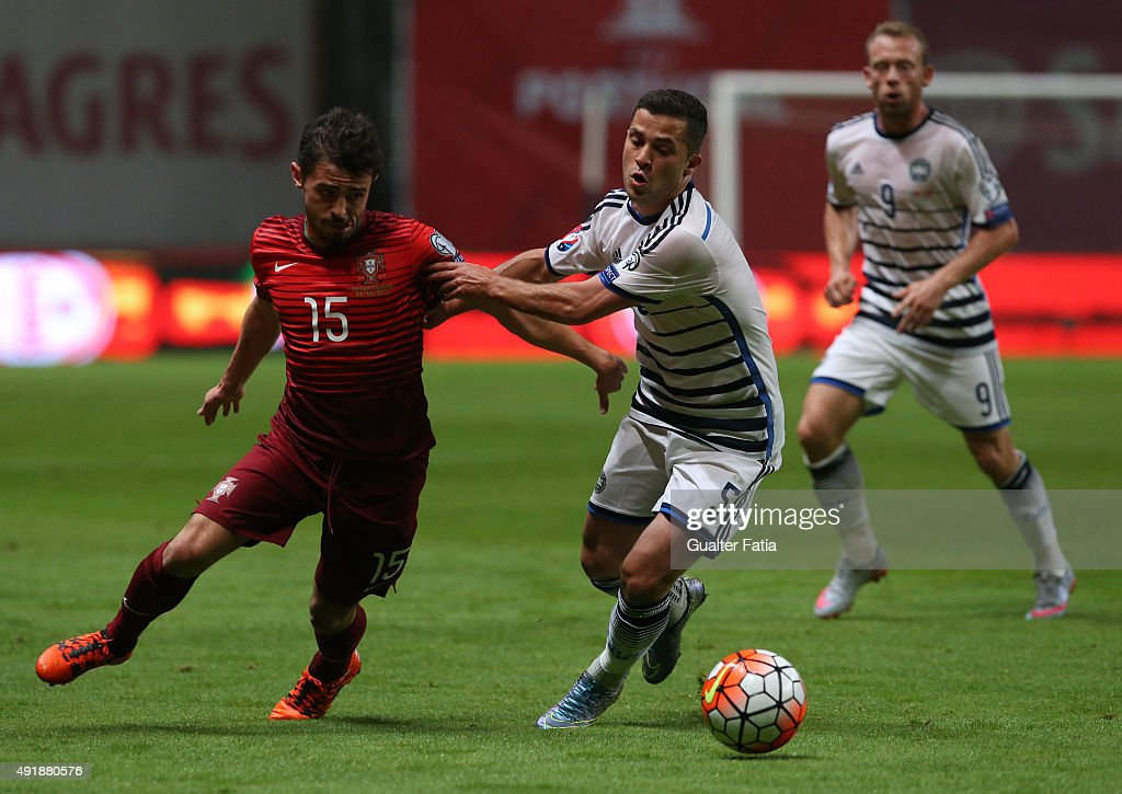 Portugal's midfielder Bernardo Silva with Denmark's Riza Durmisi in action during the UEFA EURO 2016 Qualifier match between Portugal and Denmark at Estadio Municipal de Braga on October 8, 2015 in Braga Portugal.