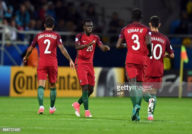 Portugal's midfielder Bruma celebrates scoring with his teammates during the UEFA U21 European Championship Group B football match Portugal v Spain...
