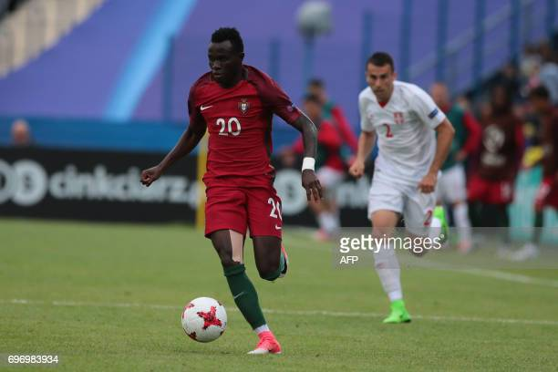 Portugal's midfielder Bruma is chassed by Serbia's defender Milan Gajic during the UEFA U21 European Championship Group B football match Serbia v...