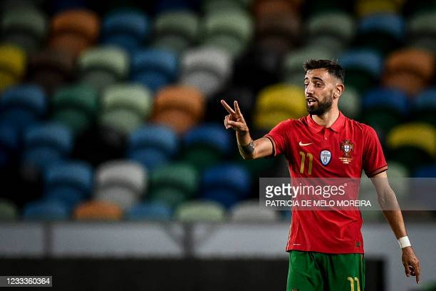 Portugal's midfielder Bruno Fernandes celebrates scoring his team's second goal during the international friendly football match between Portugal and...