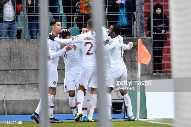 Portugal's midfielder Bruno Fernandes celebrates with teammates after scoring a goal during UEFA Euro 2020 Group B qualification football match...