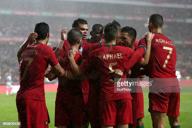 Portugal's midfielder Bruno Fernandes celebrates with teammates after scoring during the FIFA World Cup Russia 2018 preparation football match...
