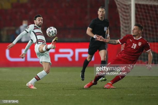 Portugal's midfielder Bruno Fernandes fights for the ball with Serbia's midfielder Sergej Milinkovic-Savic during the FIFA World Cup Qatar 2022...