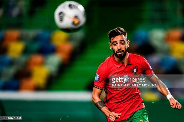 Portugal's midfielder Bruno Fernandes runs for the ball during the Nations League A group 3 football match between Portugal and Sweden at the...