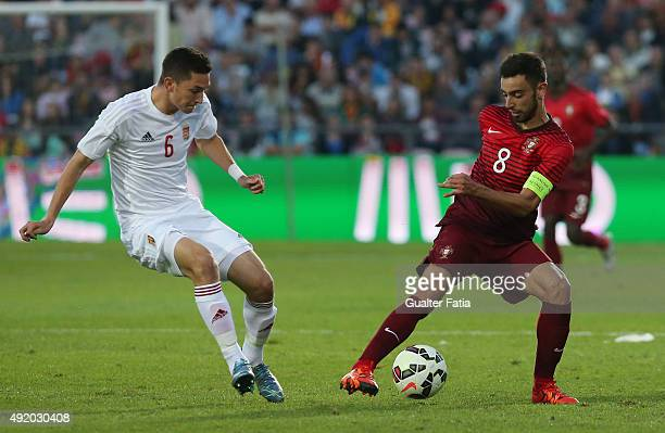 Portugal's midfielder Bruno Fernandes with Hungary's midfielder Mate Vida in action during the UEFA European Under 21 Championship Qualifier match...
