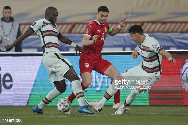 Portugal's midfielder Danilo Pereira and Portugal's defender Jose Fonte fight for the ball with Serbia's midfielder Dusan Tadic during the FIFA World...