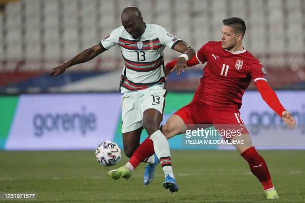 Portugal's midfielder Danilo Pereira fights for the ball with Serbia's midfielder Luka Jovic during the FIFA World Cup Qatar 2022 qualification Group...