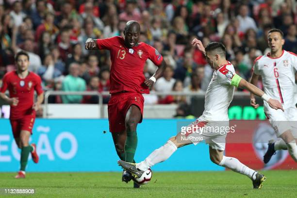Portugal's midfielder Danilo vies with Serbia's forward Dusan Tadic during the UEFA EURO 2020 group B qualifying football match Portugal vs Serbia at...