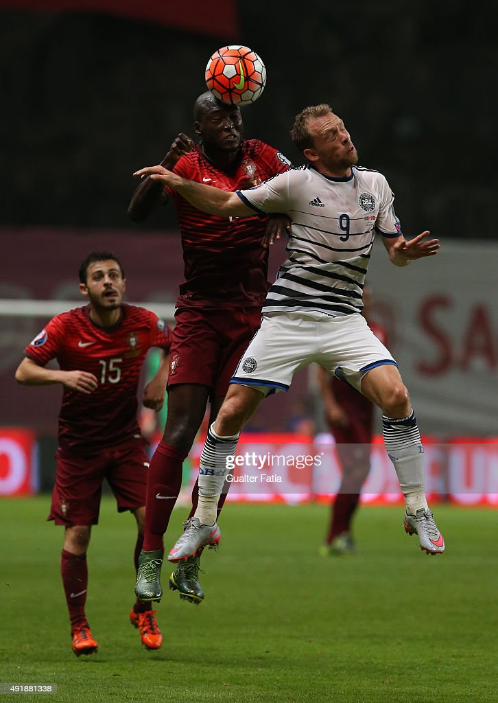 Portugal's midfielder Danilo with Denmark's Michael Krohn-Dehli in action during the UEFA EURO 2016 Qualifier match between Portugal and Denmark at Estadio Municipal de Braga on October 8, 2015 in Braga Portugal.